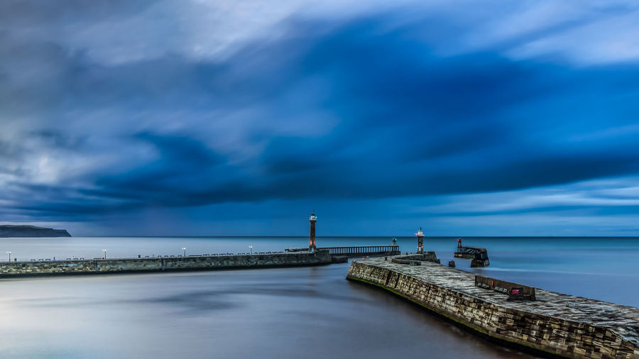 A night time long exposure of Whitby Harbour on the North Yorkshire coast. Coastline Landscape Night Photography Nightphotography North Yorkshire Architecture Beauty In Nature Building Exterior Built Structure Cloud - Sky Coast Horizon Over Water Industry Landscape Landscape_photography Lighthouse Nature Nightlife No People Outdoors Scenics Sea Sky Water