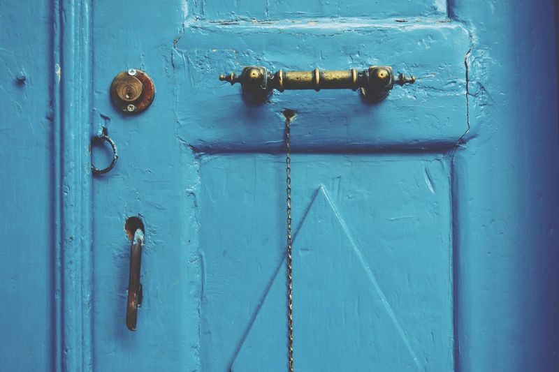 Blue door in bodrum EyeEm Selects Door Entrance Blue Metal Closed Security No People Safety Protection Close-up Lock Backgrounds Full Frame Old Wood - Material Day Knob Handle Front Door Latch