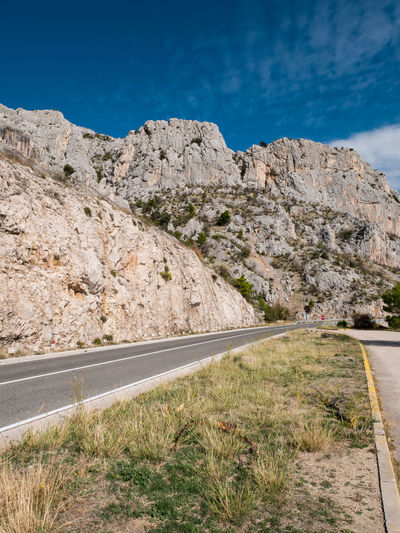 Empty scenics road on rocky coastline of Makarska riviera Transportation Road Mountain Sky Direction Nature Rock Day No People Environment Outdoors Nobody Empty Asphalt Scenics Way Croatia Makarska Riviera Europe Tree Travel Trip Destination Summer Drive Blue Rocky Traffic