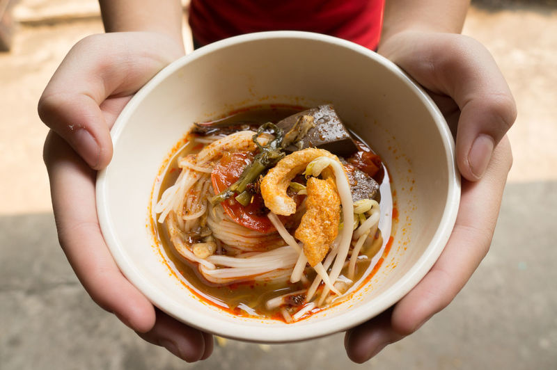 Traditional Northern Thailand Food White Noodles Spicy Soup in a Bowl, Khao Soi Nam Ngeaw, Chiangmai, Chiagrai Adult Adults Only Close-up Day Freshness Human Body Part Human Hand Nam Ngeaw Noodles Soup One Person One Woman Only Only Women Outdoors People Ready-to-eat