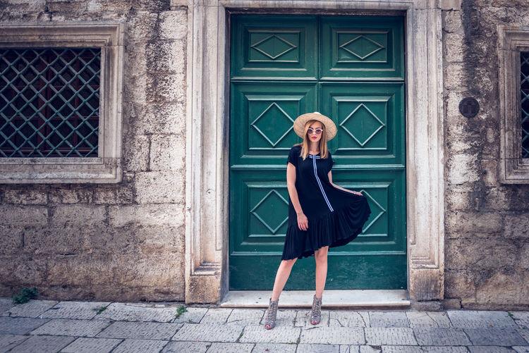 Full length of woman standing in front of door