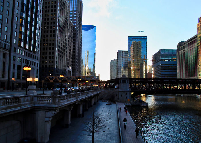Chicago downtown during evening commute on a late February winter evening. El train passes over Chicago River. Chicago Chicago River Chicago El Chicago Loop Cityscape Commuter Downtown Chicago Elevated Track Transit Transportation Wacker Drive Architecture Bridge - Man Made Structure Building Exterior Built Structure Commute Elevated Train Outdoors Riverwalk Skyscraper Tracks Train Travel Destinations Urban Skyline Wells Street