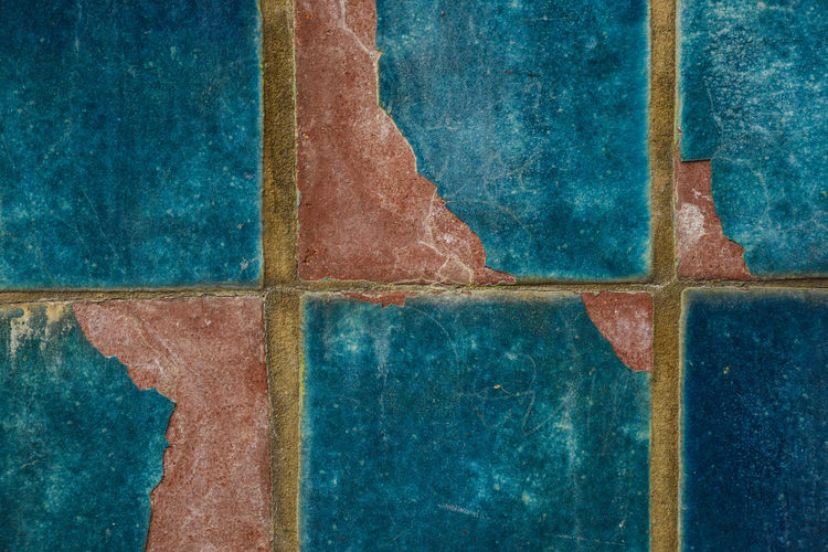Old ceramic tiles on the drinking fountain in the streets of Vienna Architecture Backgrounds Blue Blue Sky Close-up Day Full Frame Geometric Shape Green Color No People Obsolete Red Textured  Tile Weathered