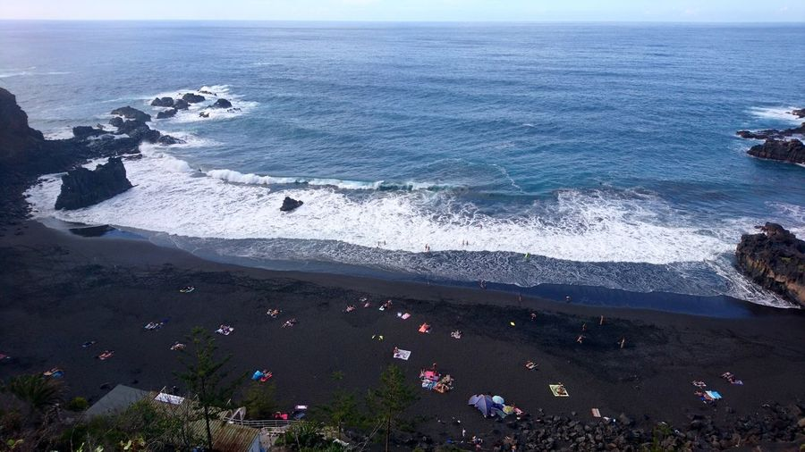 Black beach. Tenerife SPAIN España Canary Islands Islas Canarias Black Black Sand Black Beach Beach Playa Atlantic Ocean Atlantic Vacations Vacation People Water Wave Sea Beach Sand Blue High Angle View Sky Horizon Over Water
