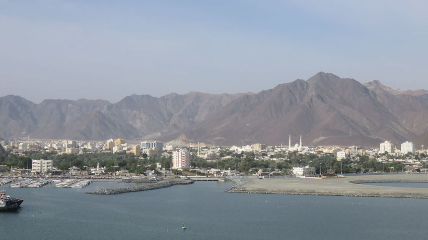 Architecture Building Exterior Built Structure City Cityscape Khor Fakkan Mode Of Transport Mountain Mountain Range Nautical Vessel Residential District Residential Structure River Sea Town Transportation Water Waterfront