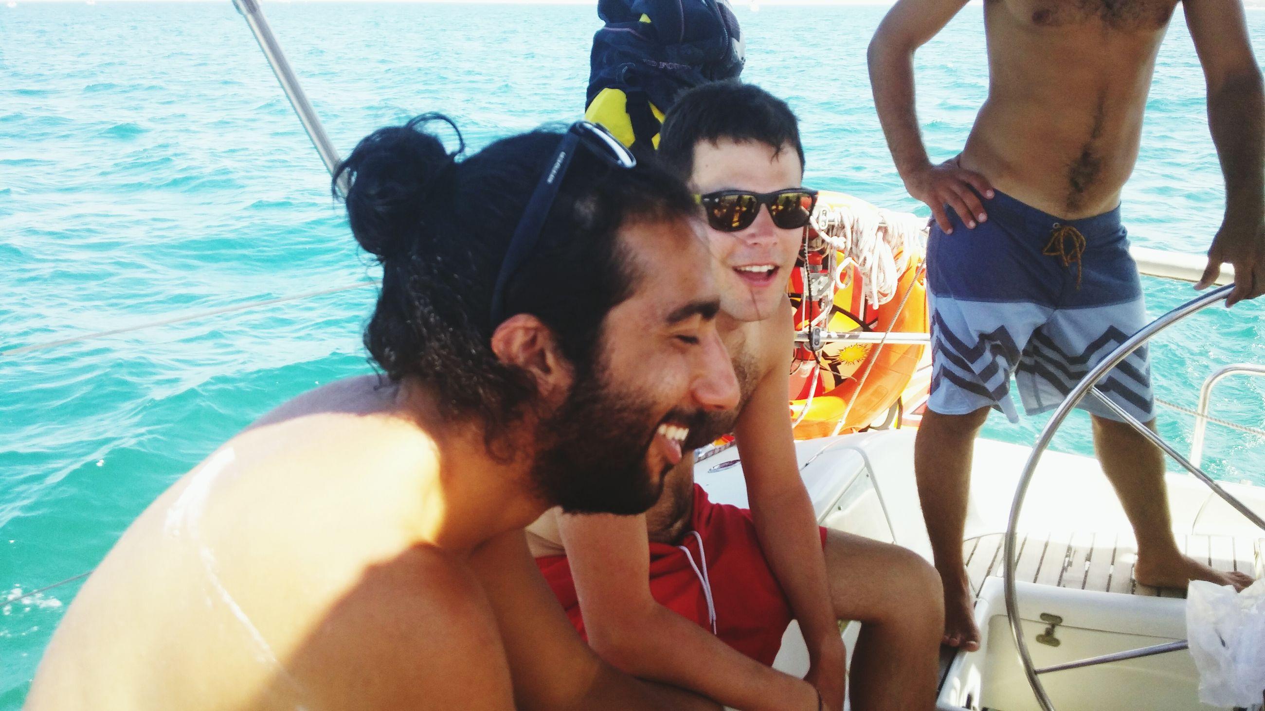 lifestyles, leisure activity, water, togetherness, men, bonding, transportation, friendship, sea, love, mode of transport, nautical vessel, vacations, enjoyment, sitting, person, travel, fun