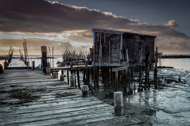 Architecture Beauty In Nature Built Structure Cloud - Sky Nature No People Outdoors Pier Post Scenics - Nature Sea Sky Sunset Tranquil Scene Tranquility Water Wood - Material Wooden Post