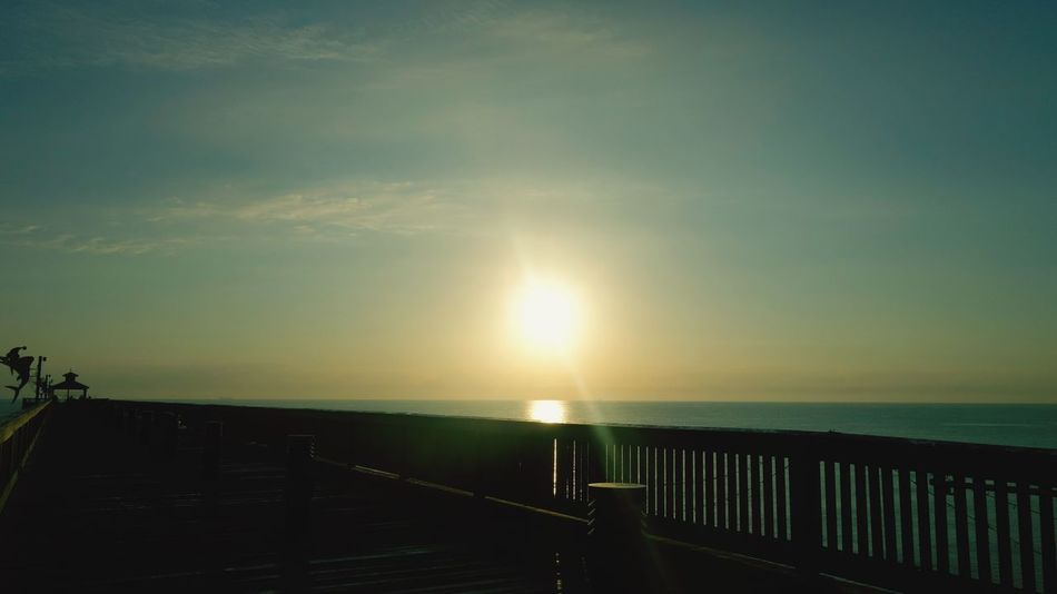 Haze In The Morning Sun Hazey Sun Pier View Sea Sun Railing Horizon Over Water Tranquility Scenics Sunlight Water Beauty In Nature Nature Tranquil Scene Outdoors Sky Idyllic No People Beach Day Sunset