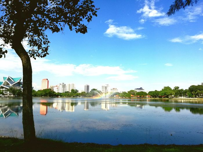 Nature Tranquil Scene City Reflection Built Structure Sky Lake Cloud - Sky Blue Sky Shiny Day Artificial Rainbow
