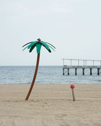 Beach Sea Sand Outdoors Water Palm Palm Tree Palmtree Coney Island New York Brooklyn Manmade Day Minimal Minimalism No People Plastic Tree Contemporary USA