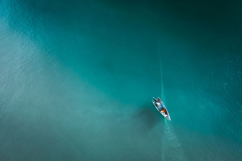 High angle view of person on boat in sea
