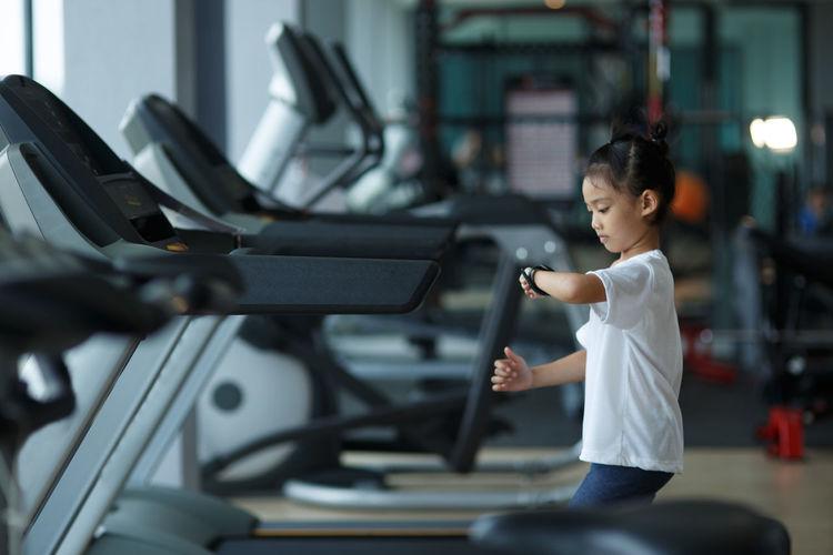 Cute girl exercising at gym