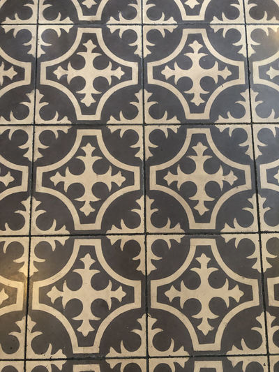 Grey and white tiled floor in Lisbon, Portugal Lisbon Portugal Tile Ceramic Tiled Pattern Full Frame Backgrounds Design Floral Pattern No People Wall - Building Feature Indoors  Built Structure Architecture Wallpaper Art And Craft Close-up Flooring Textured  Security Repetition Entrance Ornate Tiled Floor
