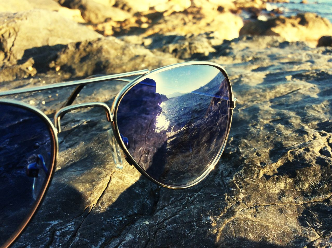 sunglasses, reflection, no people, close-up, outdoors, day, water, nature, sunlight, landscape