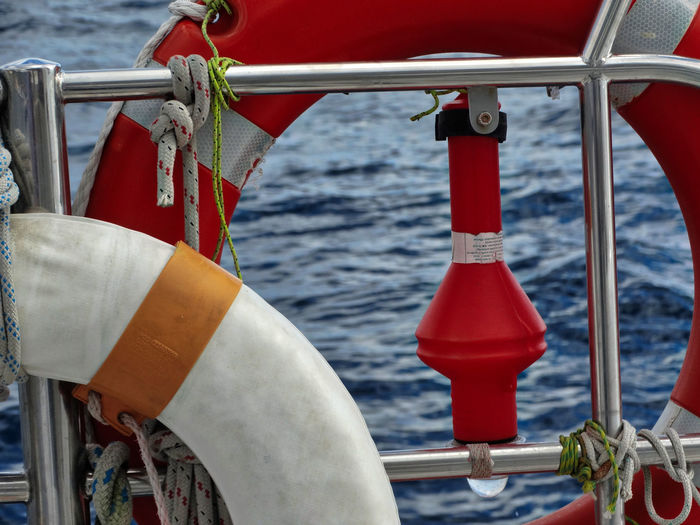 Life rings on boat. Water Nautical Vessel Sea Red Mode Of Transportation Transportation Day No People Nature Metal Focus On Foreground Rope Railing Outdoors Safety Close-up Buoy Security Protection Sailboat Wheel Life Belt Life Bouy Life Ring Boat Boats