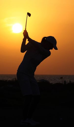 Golf Golfing Beach Beauty In Nature Golf Swing Horizon Over Water Nature One Person Orange Color Outdoors People Scenics Sea Silhouette Sky Sun Sunset Water