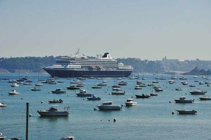 Prinsendam Luxury Cruise Ship Holland American Lines at Saint Malo France Rance Estuary Shoreline Trees Boats Tide Coming In Boats Moored