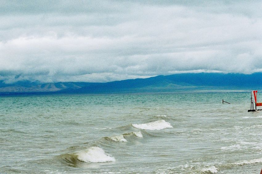 青海湖 Sea Cloud - Sky Sky Water Nature Scenics Beach Beauty In Nature Day Tranquility Outdoors No People Mountain Horizon Over Water Wave Canon Film Ae-1
