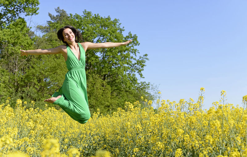 joyful leap Caper Confidence  Freedom Fun Jump Action Beauty In Nature Clear Sky Day Field Flying Full Length Green Color Happiness Joyful Leap Jumping Lifestyles Nature One Person Outdoors Plant Smiling Yellow Young Adult Young Women