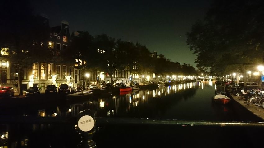 Amsterdam canal. Amsterdam The Netherlands Netherlands Holland Night Darkness Mystery Cityscape Reflections Lights Night Lights Canal Waterway Sky Light Pollution City Water Illuminated Reflection Sky Architecture