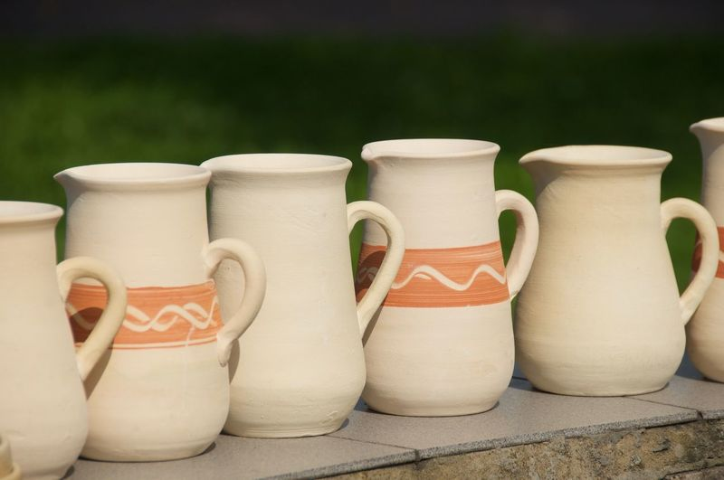 Close-Up Of Ceramic Jugs