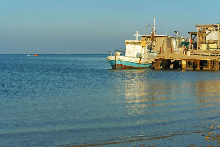 Cyprus Liopetri Beach Beauty In Nature Boat Clear Sky Day Fisherman Boat Horizon Over Water Mode Of Transport Moored Nature Nautical Vessel No People Outdoors Scenics Sea Sky Tranquility Transportation Water Waterfront Chemistart