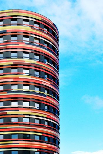 HochRundBunt. Architecture Architectural Feature Architecture_collection Architectural Detail Façade Textures And Surfaces Close-up Multi Colored Colorful No People Cloud - Sky Building Exterior Day Sky Adapted To The City City Life Window Silhouette Striped Round Corner The Architect - 2017 EyeEm Awards Hamburgmeineperle The City Light Modern Architecture Facades