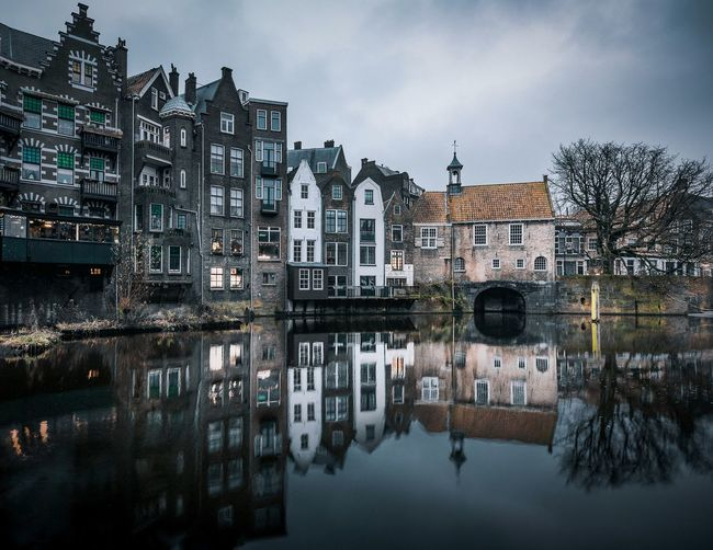 Reflection of the Delfshaven EyeEmNewHere Holland Delfshaven Reflection Architecture Water Waterfront Building Exterior Sky Canal Built Structure No People Standing Water Cloud - Sky Day Tree Nautical Vessel Lake Outdoors Nature City
