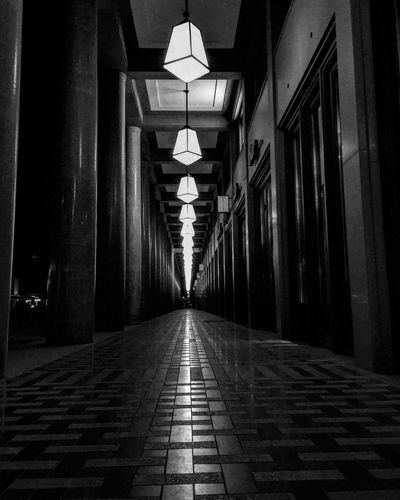 The Way Forward Illuminated Architecture Built Structure Corridor No People Night Modern Architecture Light And Shadow Street Photography Monochrome Black & White Blackandwhite Photography Black And White Shadow Bnw City Outdoors Building Exterior Architecture Lighting Equipment Light Nightphotography Nightshot EyeEm Awards 2017