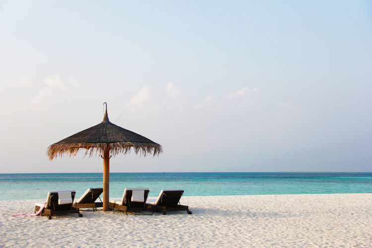 White Sand Maldives Straw Umbrella Beach Umbrella Deck Umbrella Umbrella Beach Deck Chair Sunshine Light Blue Blue Vacations Day No People Nature Beach Beauty In Nature Scenics - Nature Tranquility Horizon Over Water Tranquil Scene Horizon Water Sky Sea Parasol
