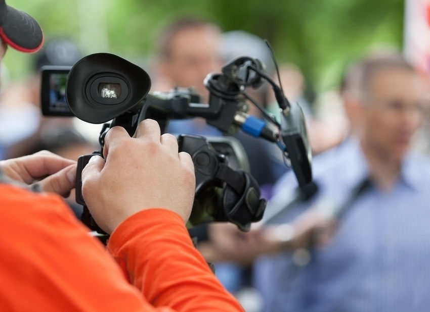 Filming an media event with a video camera Adult Businessman Camerman Conference Event Hanging Out Holding Holding Hands Human Body Part Interview Interview Journalist Journalist Media Men Microphone Micrphone People Press Reportage Technology Tv
