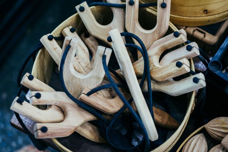 Basket of wooden slingshots at a market