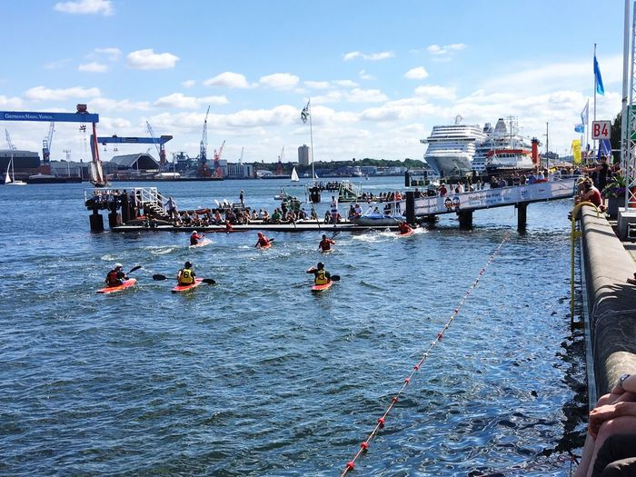 Kanupolo Kieler Förde Nautical Vessel Large Group Of People Water Transportation Mode Of Transport Real People Day Sky Men River Cloud - Sky Outdoors Leisure Activity Women Nature Adult People Kielerwoche Kieler Woche Kieler Woche 2017 Crowd Group Of People Rowing Sport Waterfront