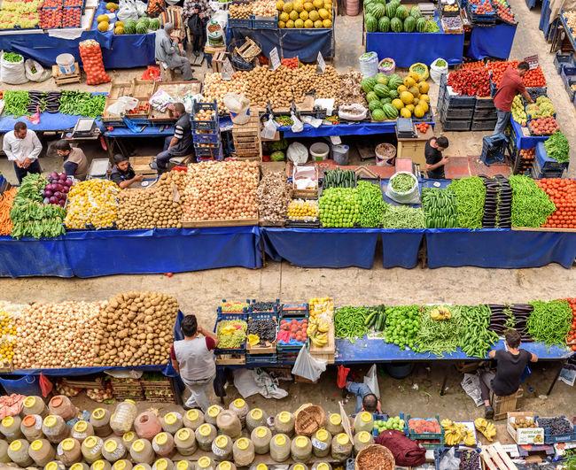 Melike Hatun Bazaar or kadinlar pazari(Women Bazaar) that is a traditional Turkish grocery bazaar where people buy Vegetables, fruits and spices in Konya,Turkey Konya Kadınlar Pazarı Bazaar Pazar Turkey Women Agriculture, Apple, Basket, Bazaar, Buy, Colorful, Food, Fresh, Fruit, Fruits, Grape, Green, Greengrocery, Grocery, Group, Health, Healthy, Kadinlar, Konya, Lemon, Market, Marketplace, Organic, Pazar, People, Produce, Raw, Red, Row, Sale, Sell, Shop, Shopping, Spices, Stall, Stand, Store, Top, Traditional, Turkey, Turkish, Various, Vegetables Market Food And Drink Food Market Stall Fruit Healthy Eating Choice Retail  Variation For Sale Vegetable Freshness Wellbeing Real People Small Business Large Group Of Objects People Selling Abundance Men Buying Vendor Sale Retail Display Outdoors