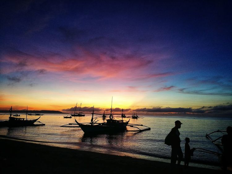 HuaweiP9 Philippines Beach Sea Silhouette Sunset Water Nautical Vessel Sky Fisherman Nature Tranquility Fishing Outdoors Beauty In Nature People Sand Horizon Over Water