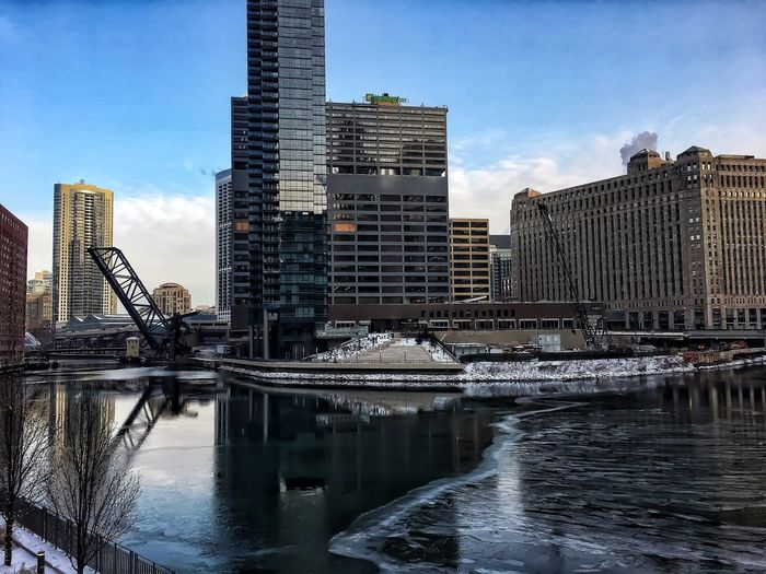 Ice chunks floating on Chicago River on frigid January day. Chicago Chicago River Chicago Riverwalk Chicago Loop Cityscape Downtown Chicago Elevated Track Frozen January Reflection Rush Hour Winter Bridge Bridge - Man Made Structure Cold Temperature Drawbridge  Elevated Train Frozen River Frozen Water Shadows Snow Tower Waterfront