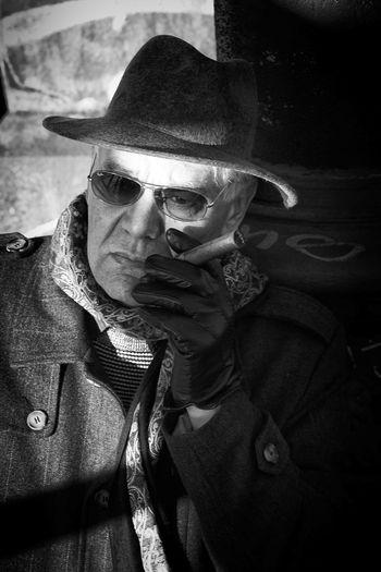 Close-up of man smoking cigar