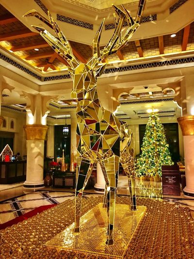 Christmas bling Modern Sculpture Mirror Gold ShotOnIphone Travel Destinations Seasons Dubai IPhoneography Seasonal Luxury Hotel Golden Reindeer Christmastime Christmas Decoration Indoors  No People Architecture Luxury Day