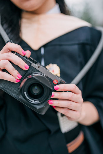 One Person Holding Front View Real People Human Hand Adult Focus On Foreground Technology Camera - Photographic Equipment Midsection Hand Lifestyles Nail Polish Photography Themes Black Color Activity Casual Clothing Women Nail Digital Camera SLR Camera Photographer Leicacamera Leicaq Leica