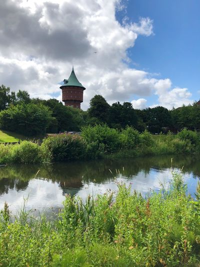 • Stadtansicht mit Wasserturm • EyeEm Nature Lover Cuxhaven Landmark Watertower Water Plant Sky Cloud - Sky Nature Architecture Tree Built Structure Day Growth Beauty In Nature Tranquility No People Building Green Color Reflection