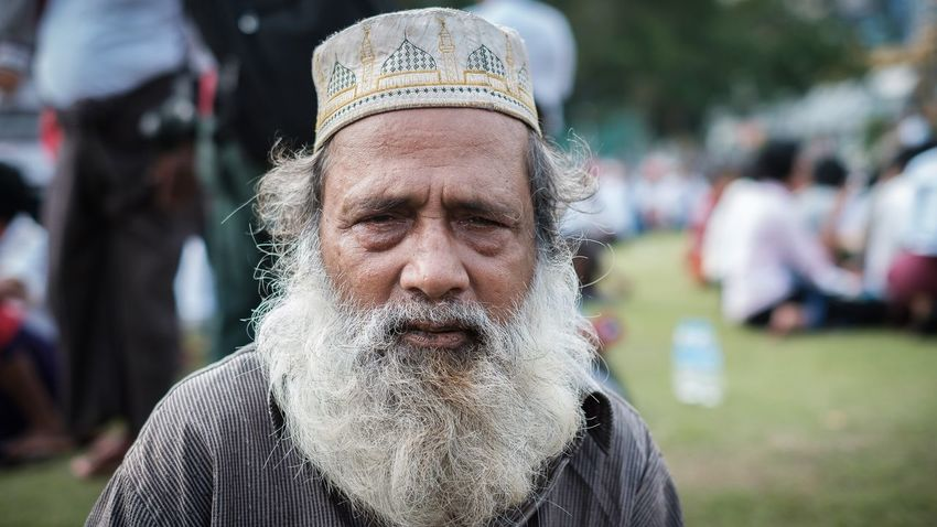 This man asked me to make a portrait of him while sitting at the Maha Bandula Park in downtown Yangon Myanmar Myanmar Yangon EyeEm Selects Portrait One Person Lifestyles Front View Real People Headshot Focus On Foreground Close-up Outdoors
