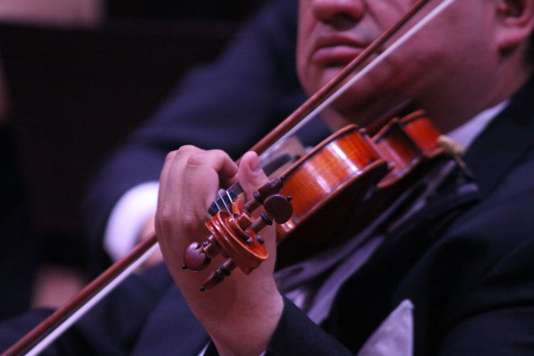 Midsection Of Mature Man Playing Violin