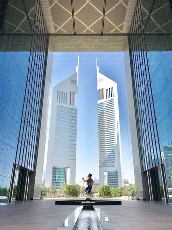 Jumpstart your week and beat that Sunday blues. Chadventurestories Dubai Mydubai UAE Architecture Built Structure Building Exterior Real People Day Full Length Modern Outdoors City Skyscraper Sky One Person People Creativity Shootermag EyeEm EyeEm Best Shots Jumpshot Let's Go. Together. Architecture Photography