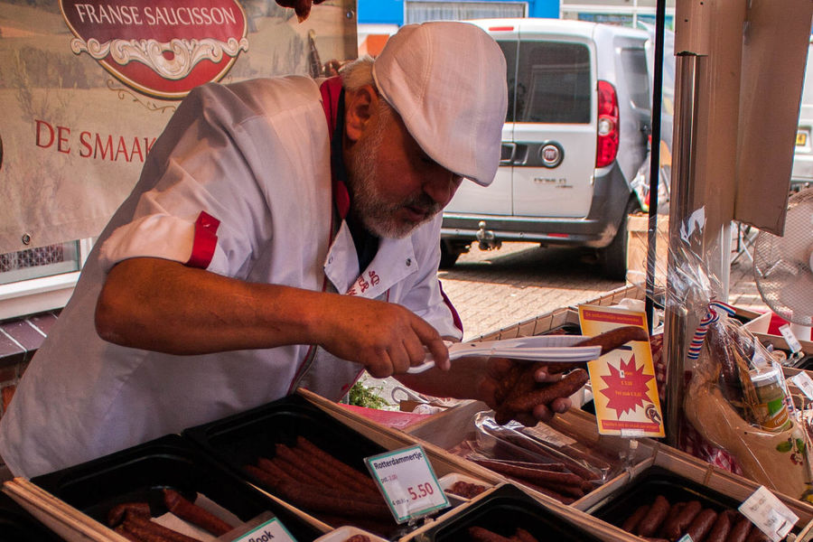 Bruinisse [NL] Fisherman's Days 2017 Saucage Foodstall Vending Selling Streetphotography Street Photography Market Stall Man Butcher Market Food Food Stall Food Stories