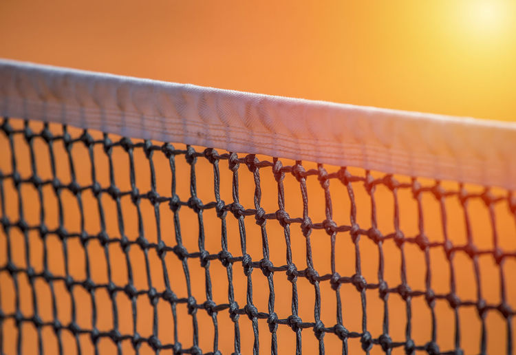 Close-up of sport net during sunset