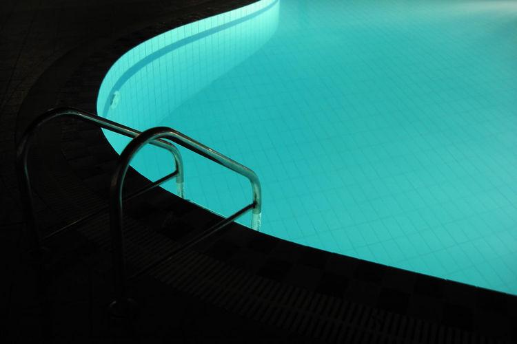 Empty swimming pool at night