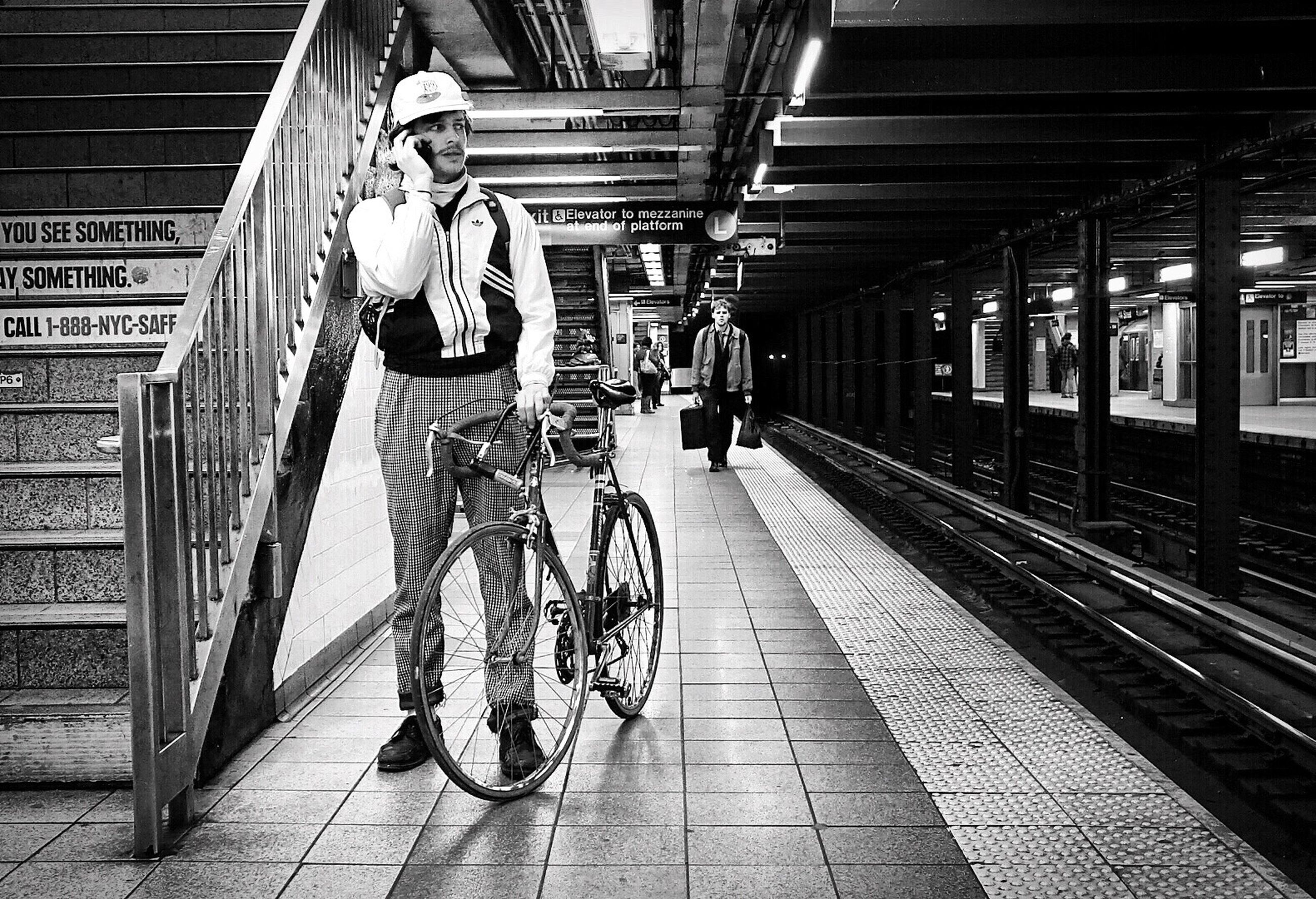 transportation, the way forward, mode of transport, architecture, railroad station platform, built structure, railroad station, men, public transportation, railroad track, rail transportation, diminishing perspective, incidental people, travel, walking, vanishing point, indoors, bicycle