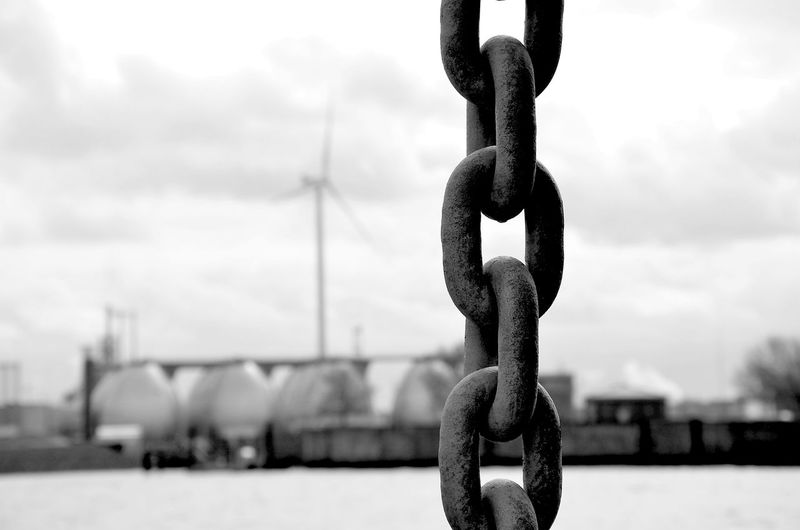 Close-Up Of Chain Against Sky