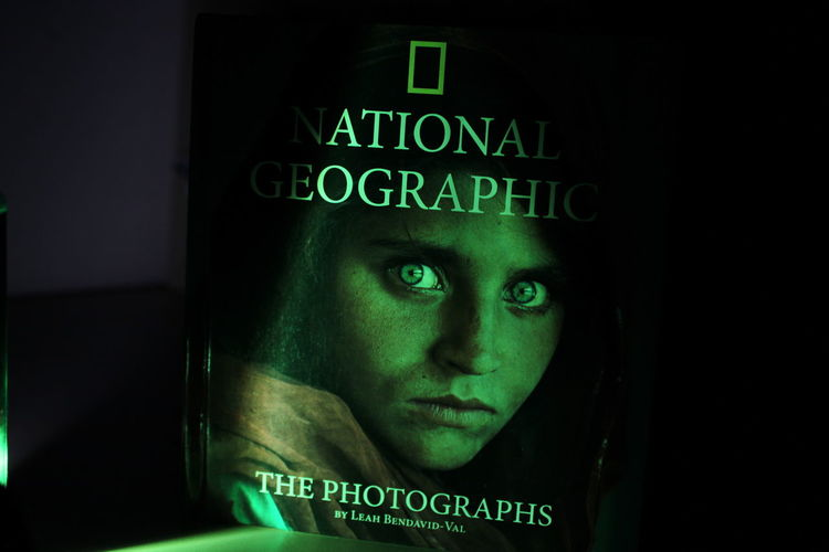 natgeo book cover Human Face Portrait Headshot Close-up Green Color Aircraft Wing Non-western Script Capital Letter Peeking Information Stop Sign Text No Parking Sign Information Sign Single Word Keyboard Written Warning Thoughtful Eyeball Signboard Iris - Eye Warning Sign Alphabet Board Western Script Pretty Eyelash
