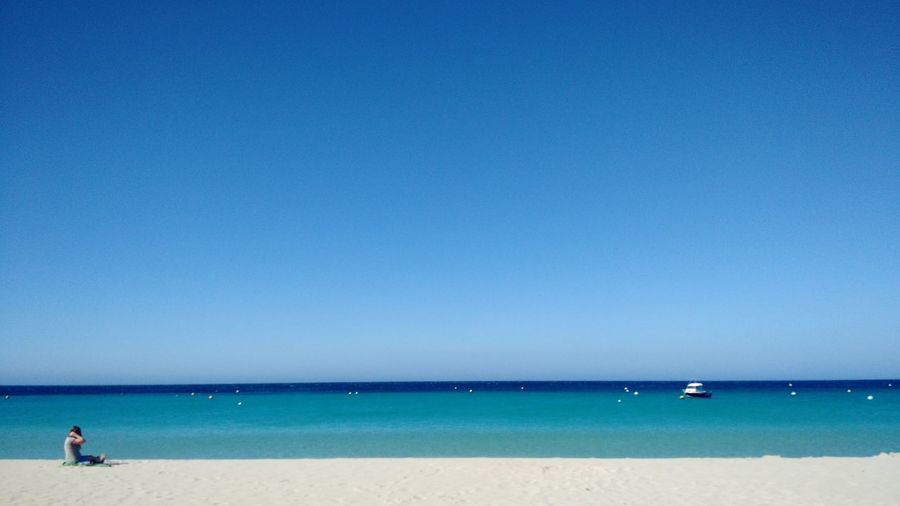 Sea Blue Water Clear Sky Horizon Over Water Beach Scenics Nature Sky Sand Beauty In Nature Tranquility Vacations Outdoors Day No People